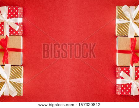 many beautiful decorated christmas gits on red background