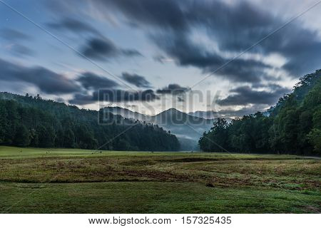 Streaky Clouds Over Remote Valley at Sunrise in North Carolina mountains