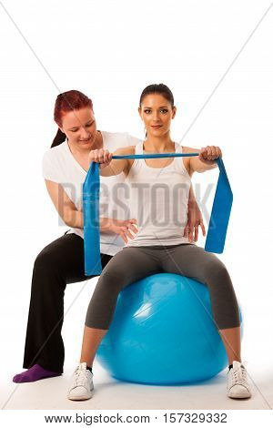Physiotherapy - Therapist Doing Arm Strenghteninh Excercises With A Patient To Recover Strenght Afte