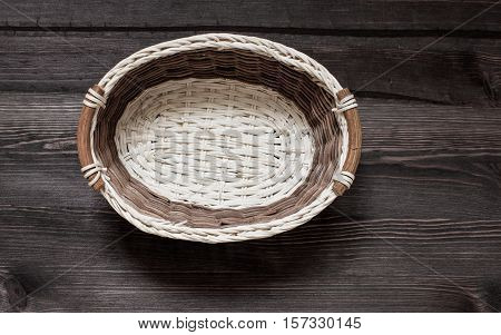 Basket from a tree on a wooden background.