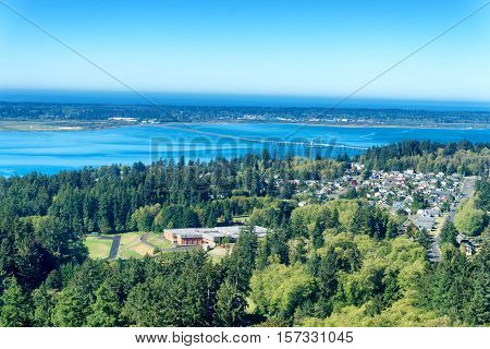 Cityscape view of Astoria Oregon with the Pacific Ocean in the background