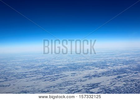 Aerial view from the plane of Siberia winter in snow