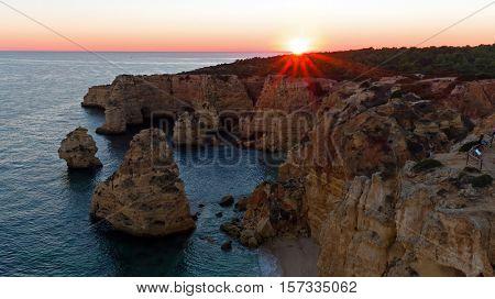 Aerial from Praia da Marinha in the Algarve Portugal at sunset