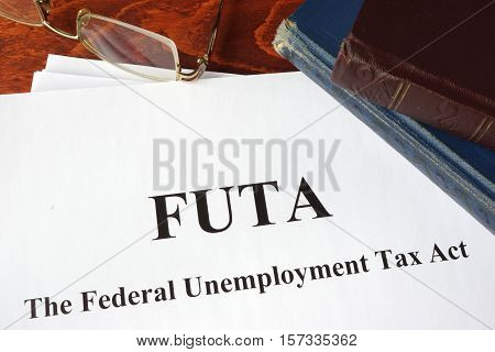 Papers with FUTA Federal Unemployment Tax Act.