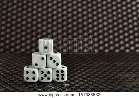 Six dices isolated on a black background