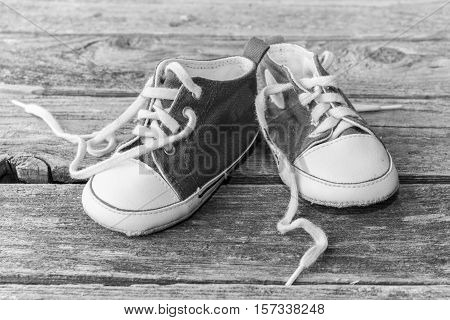baby sneakers in black and white photography