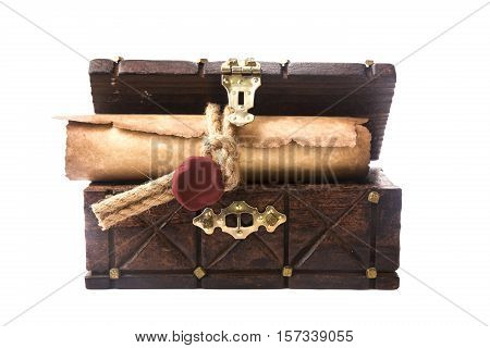 The ancient chest and a scroll with a seal isolated on white background