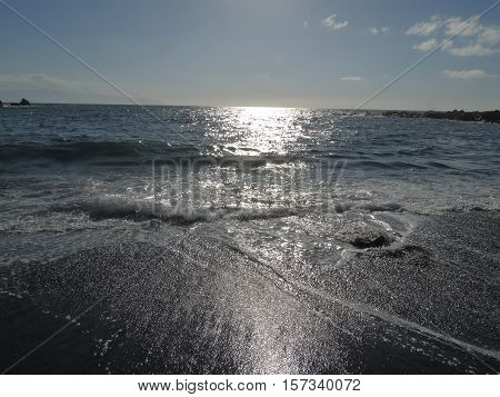 nthe sun and waves Atlantic black beaches of Tenerifeight over the ocean farewell to the sunset over the horizon