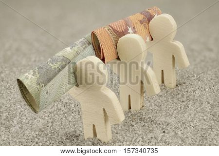 Three wooden figures  carry money notes - close-up