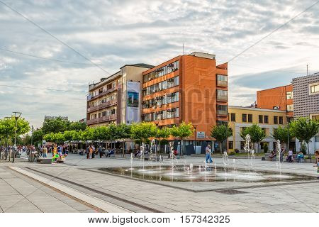 PRISTINA, KOSOVO - JULY 01, 2015: People walking by the new fountain on Scanderbeg square in city center.
