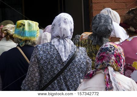 Tutaev, Russia - August 01, 2016: queue of old women to the church