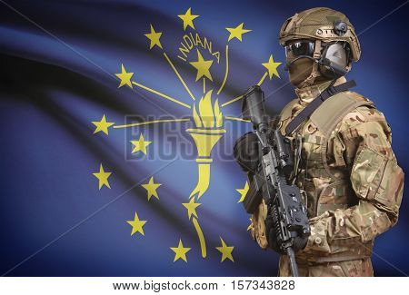 Soldier In Helmet Holding Machine Gun With Usa State Flag On Background Series - Indiana