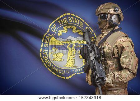 Soldier In Helmet Holding Machine Gun With Usa State Flag On Background Series - Nebraska