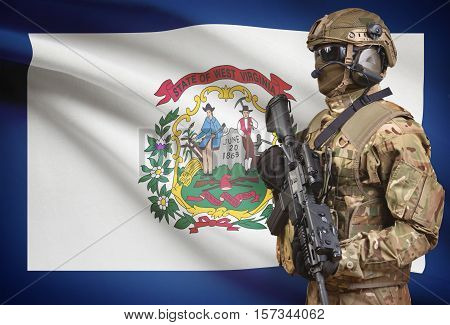 Soldier In Helmet Holding Machine Gun With Usa State Flag On Background Series - West Virginia