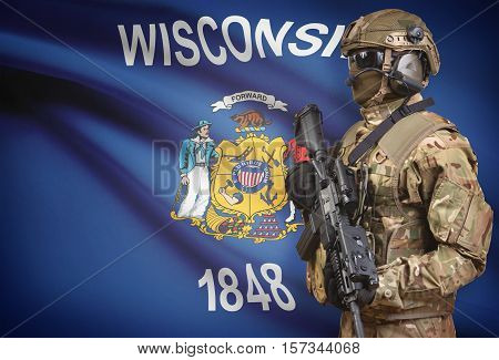 Soldier In Helmet Holding Machine Gun With Usa State Flag On Background Series - Wisconsin