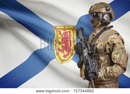 Soldier In Helmet Holding Machine Gun With Canadian Province Flag On Background Series - Nova Scotia
