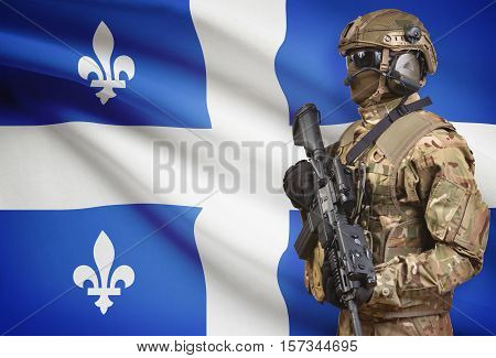 Soldier In Helmet Holding Machine Gun With Canadian Province Flag On Background Series - Quebec