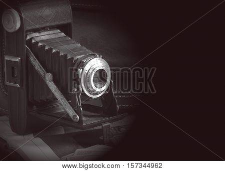 Vintage camera isolater in black background from fifties