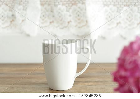 A white mug with shallow dept of field