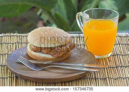 Spicy Chicken Burger with cup of orange juice