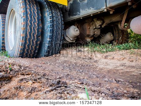 Heavy Truck stuck in the soft soil road