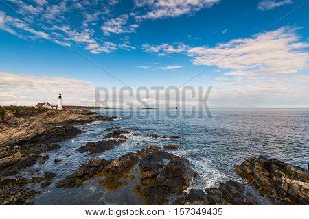 View of the Portland Headlight with a rocky coastline. Portland Maine.