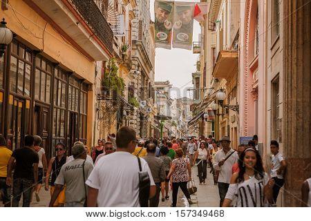 Havana city, Cuba, Nov. 26, 2013, Old vintage retro style Cuban Havana city busy street, with various people walking by