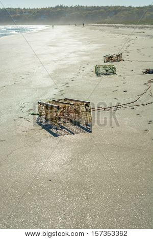 A lobster trap washed up and burried in the sand at the beach