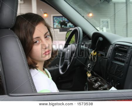 Young Girl Sitting In Car