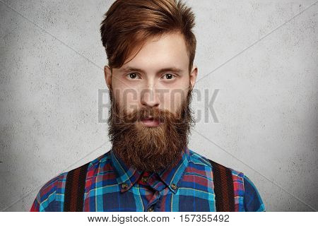 Isolated Shot Of Attractive Fashionable Caucasian Man With Fuzzy Hipster Beard And Mustache Wearing