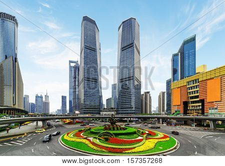 Skyscrapers And Colorful Flower Bed On Mingzhu Roundabout