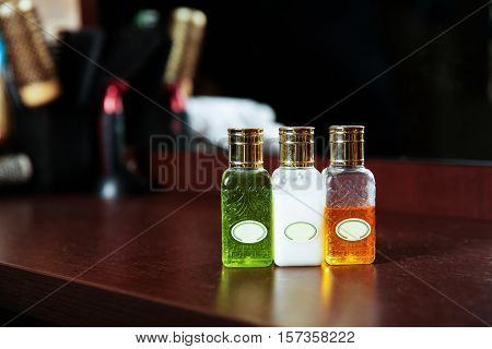 Hair care products in bottles.