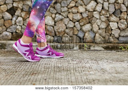 Close Up Image Of Violet Female Running Shoes During Outdoor Training. Cropped Portrait Of Woman Ath