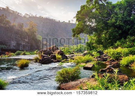 Beautiful River With Crystal Clear Water Among Woods And Rocks