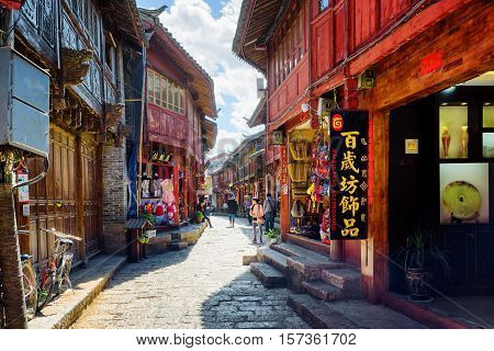 Narrow Street With Souvenir Shops In The Old Town Of Lijiang