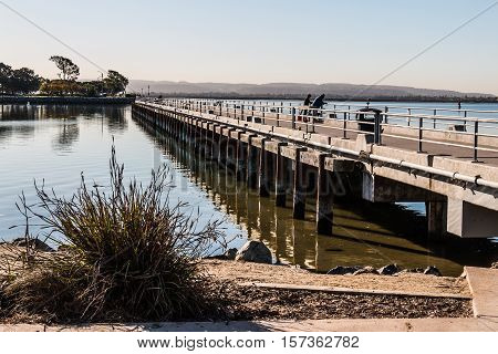 Fishing pier at Chula Vista Bayfront park with San Diego bay.