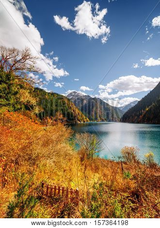 Amazing View Of The Long Lake Among Fall Woods And Mountains