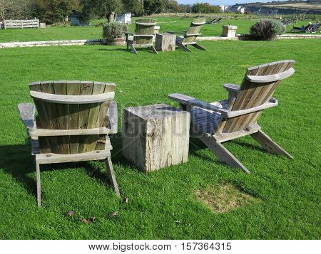 Wooden Chairs At Public Picnic Area