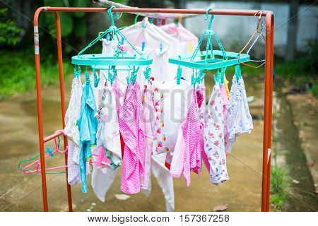 Diaper hanging on a clothes line. baby