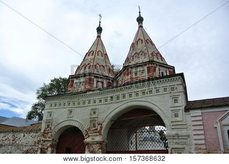 Suzdal, Russia. Sacred gate (1688) - one of the most noticeable masterpieces of the Suzdal architecture. Golden Ring of Russia. Orthodox architecture.