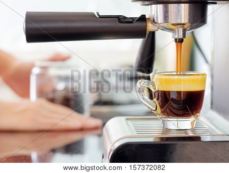 Espresso Coffee Machine In Kitchen. Hot Coffee Pouring Into Cup
