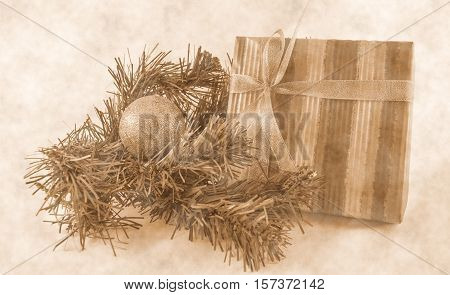 Christmas and New Year composition of Christmas tree branches, golden ball and gift boxes (sepia)