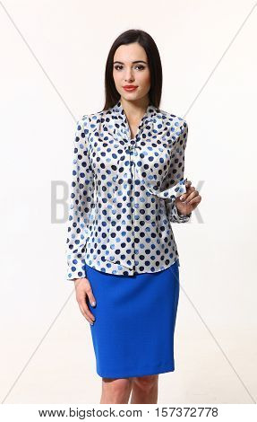 brunette business executive woman with straight hair style in official blouse and blue skirt close up portrait isolated on white