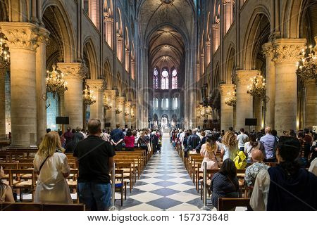 Paris France - May 082016 : Unidentified tourists visiting the Notre Dame de Paris in Paris France. The cathedral of Notre Dame is one of the top tourist destinations in Paris.