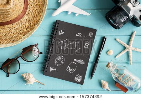 Overhead view of Traveler's accessories and items with copy space on wooden background Travel concept