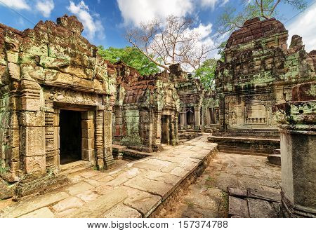Ancient Buildings With Carving Of Preah Khan Temple In Angkor