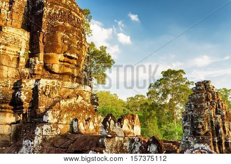 Ancient Giant Stone Face Of Bayon In Angkor Thom, Cambodia