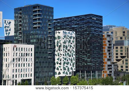 OSLO NORWAY - AUGUST 17 2016: View of The modern Oslo business district Bjorvika on Dronning Eufemias gate street. Modern architecture in in Oslo Norway on August 17 2016.