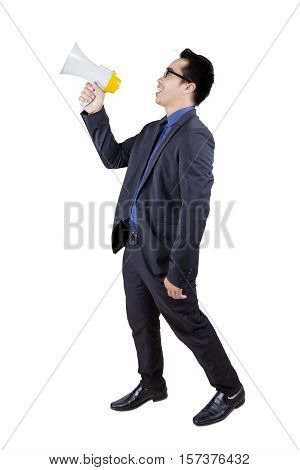 Photo of a male worker standing in the studio while talking with a bullhorn isolated on white background