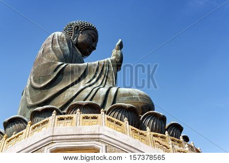 Side View Of Tian Tan Buddha On The Blue Sky Background In Hong Kong